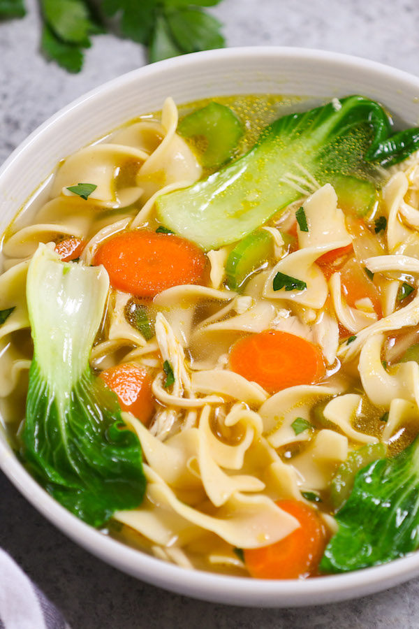 Hearty and comforting Instant Pot Chicken Noodle Soup - loaded with tender chicken, delicious noodles and nutritious vegetables. Best of all, it takes only 30 minutes when made from scratch! #InstantPotChicken # ChickenNoodle Soup