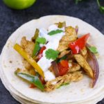Slow Cooker Chicken Fajitas – Tender and juicy chicken breasts are cooked in the crock pot with bell peppers and onions with flavorful fajita seasonings. It takes 10 minutes to prepare in the morning and you will come home with dinner ready!#ChickenFajitas #SlowCookerChicken