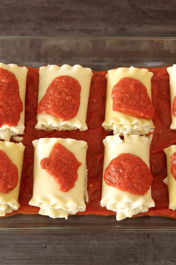 Add remaining marinara sauce evenly across tops of rolls