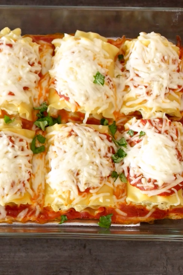 Lasagna Roll Ups packed with rich and flavorful layers of vegetables, ricotta, mozzarella, parmesan cheese and marinara sauce, wrapped in individual tender and soft lasagna pasta.  It's versatile and much easier than traditional lasagna recipe. Plus, it reheats and freezes really well!