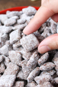 Puppy Chow is a simple and easy snack full of crunchy Chex cereal and packed with extra chocolate and peanut butter flavor!