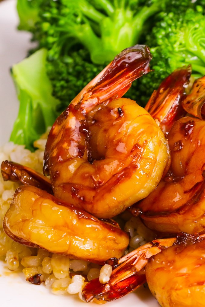 Sriracha Shrimp features succulent shrimp that's stir-fried in honey sriracha sauce. An easy recipe that's ready in under 20 minutes!