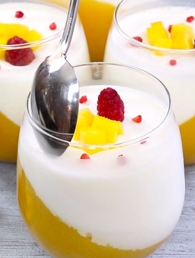 Mango Panna Cotta is a classic Italian dessert recipe with stunning mango layer and creamy vanilla panna cotta layer. This panna cotta recipe is the perfect make-ahead dessert and it's the best mango recipe I've ever made!