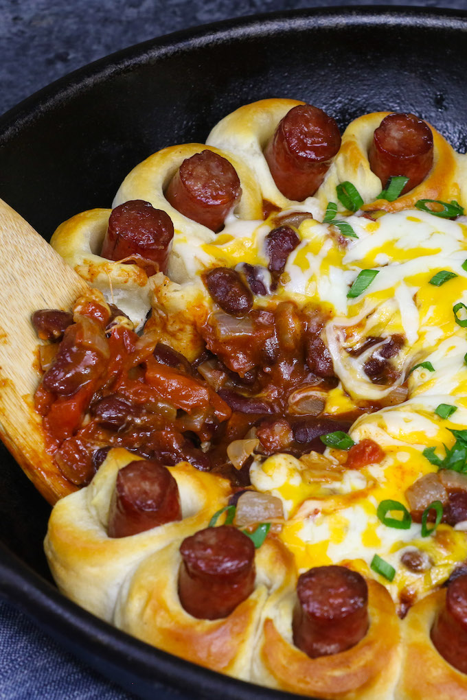 This Chili Dog Casserole is hot dog wrapped with biscuit dough, then baked in a homemade chili sauce with shredded cheese. An easy Tex Mex meal tastes like your favorite Mexcian restaurant. It's the best chili dog recipe you will EVER have!