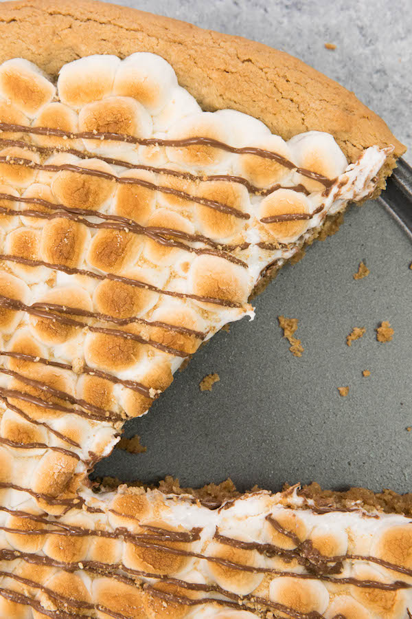 S'mores Pieis gooey, chocolatey, rich and crunchy! Graham cracker crust, toasted marshmallow and rich chocolate are baked into a delicious smores pie. It's so much better than standing around a campfire