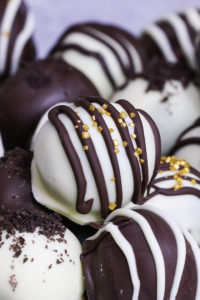 Oreo Cookie Balls are an easy bite-sized no-bake treat: crushed oreo cookies are mixed with cream cheese, and then these oreo balls are covered with chocolate. They are perfect dessert for holidays such as Christmas!