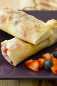Cheesecake Egg Rolls are filled with cream cheese and mixed berries, all wrapped in soft egg rolls and baked to crispy perfection. The perfect make-ahead appetizer or dessert for any event!