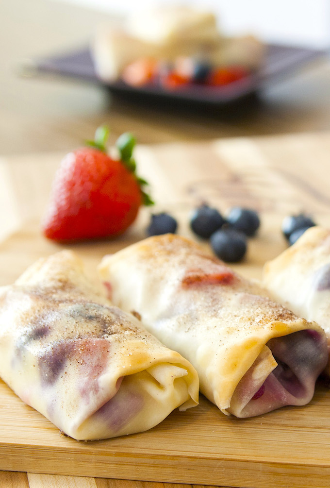 Cheesecake Egg Rolls are filled with cream cheese and mixed berries, all wrapped in soft egg rolls and baked to crispy perfection
