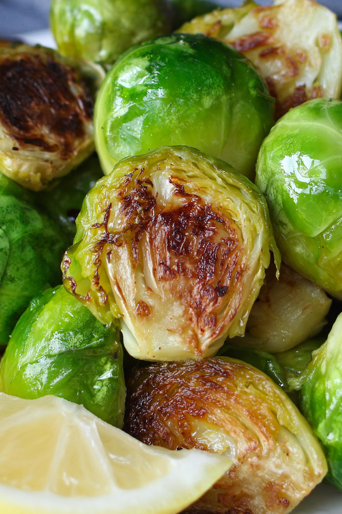 Honey Sriracha Brussels Sprouts are a sweet and spicy side dish that's super easy to make and full of flavor. Roasting brussels sprouts in the oven at a high temperature and then drizzled with honey sriracha sauce ensures the vegetables stay tender and crispy