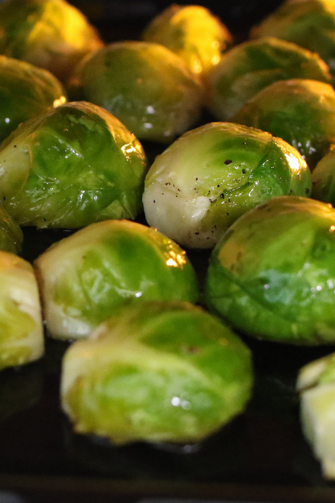 Roasting brussels sprouts on a baking sheet in the oven