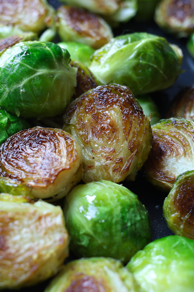 Honey Sriracha Brussels Sprouts are a sweet and spicy side dish that's super easy to make and full of flavor. Roasting brussels sprouts in the oven at a high temperature and then drizzled with honey sriracha sauce ensures the vegetables stay tender and crispy.