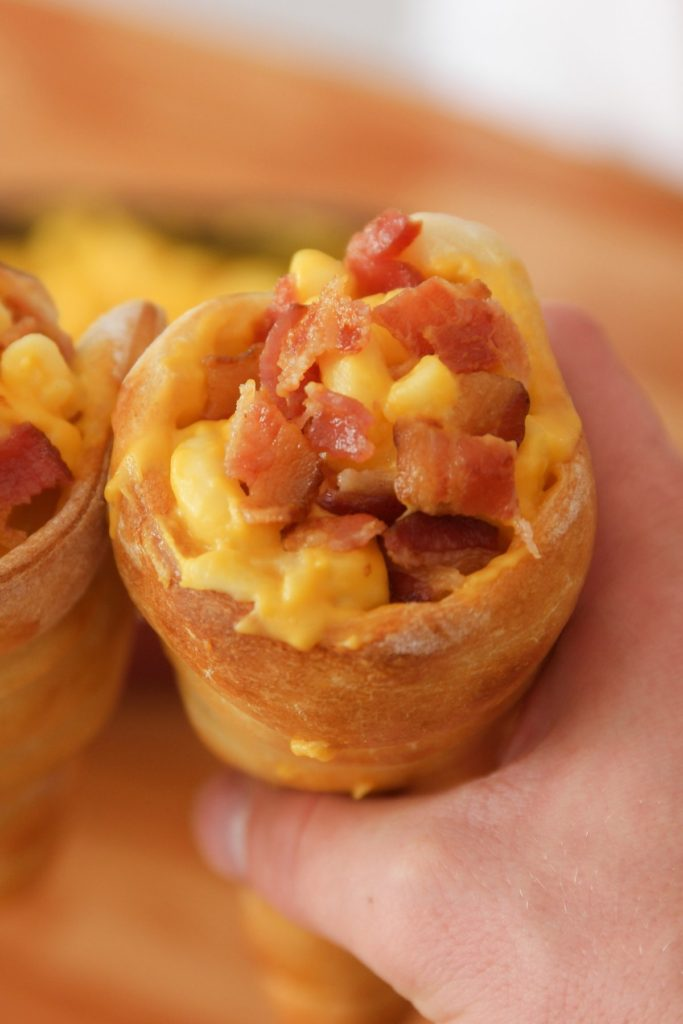 Pizza Cones are pizza dough shaped into cone form and then baked in the oven until golden brown. Add your favorite toppings into the pizza cones and they are a really fun way to eat pizza!