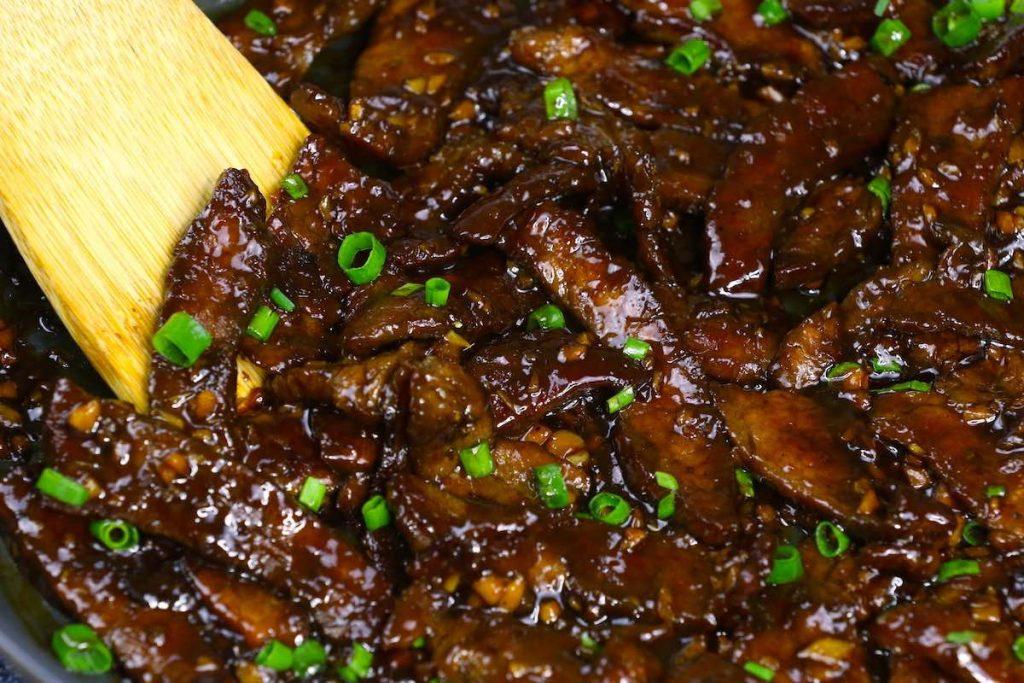 Stir fry beef slices in a skillet