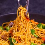 Beef stir fry with noodles, broccoli and carrots