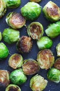 Honey Sriracha Brussels Sprouts are a sweet and spicy side dish that's super easy to make and full of flavor. Roasting brussels sprouts in the oven at a high temperature and then drizzled with honey sriracha sauce ensures the vegetable stay tender and crispy.