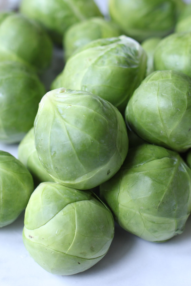 Washed Brussels sprouts on the counter.