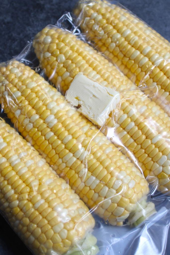 Vacuum sealed corn and butter in a zip-top bag.