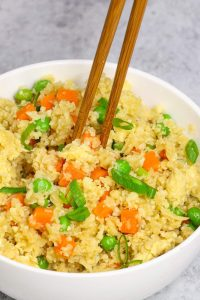 This Easy Microwave Cauliflower Rice recipe makes light and fluffy cauliflower rice in just a few minutes. An amazingly healthy and low carb twist on takeout fried rice. It's a perfect grain-free and quick side dish! #MicrowaveCauliflowerRice