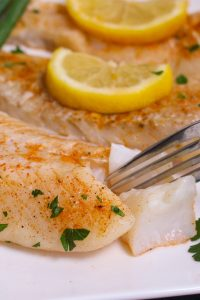 Lemon Garlic Sous Vide Cod – simple, perfect and delicious! The sous vide cooking technique takes the guess work out and allows you to cook a restaurant-quality fish dinner at home. The cod is precisely cooked to the temperature you set, with the perfect tender and flaky texture!