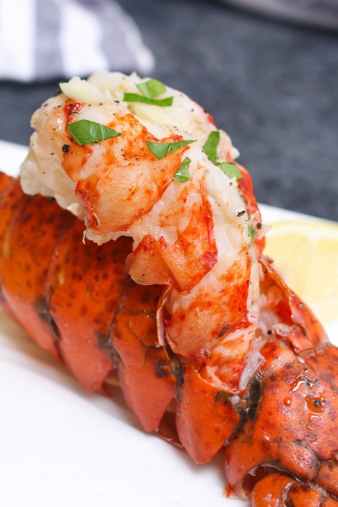 These Sous Vide Lobster Tails are incredibly tender, juicy, and full of delicious lemon butter flavor. With sous vide method, cooking lobster is no longer intimidating. This is a no-fail recipe that produces the most succulent restaurant-quality lobster at home! #SousVideLobster #SousVideLobsterTails
