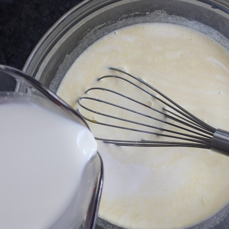 Pouring the heaving cream into the egg mixture.