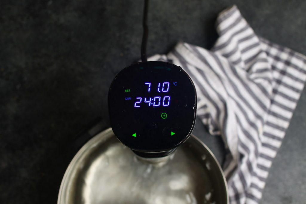 Setting the Sous Vide Precision Cooker to 160°F (71°C) for 24 hours.