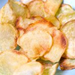 Crispy and healthy homemade Air Fryer Potato Chips made with only 3 ingredients. No oil needed! Season them up the way you like. This crunchy snack tastes so good and you'll never buy store-bought potato chips again!