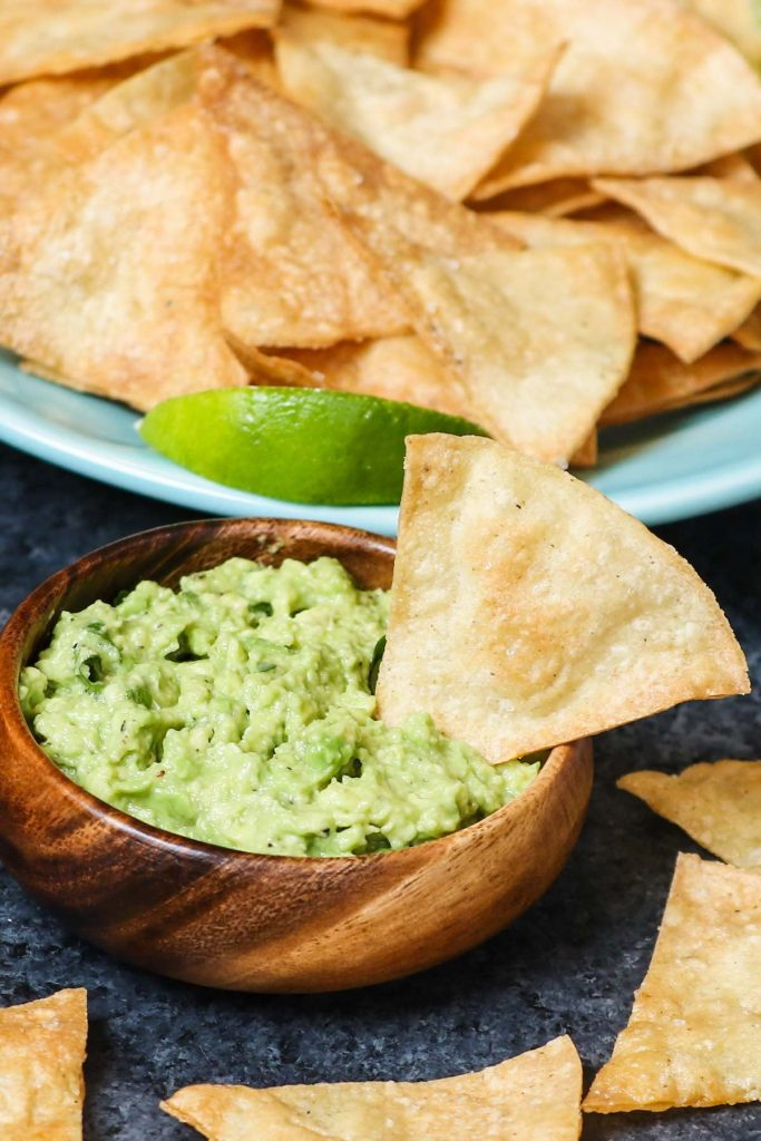 Air Fryer Tortilla Chips served with guacamole.