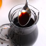Homemade Elderberry Syrup Recipe is an easy and inexpensive solution to address winter wellness goals. A delicious and immune boosting syrup that's made with dried elderberries, cinnamon, ginger, cloves, and honey. It's one of the most popular ways to fight off a cold or flu. With a few simple tips, you can now make it at home!