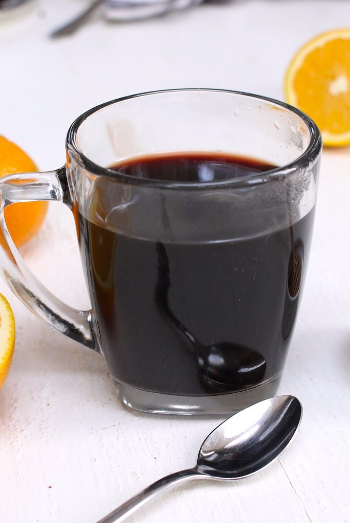 Elderberry Tea is a delicious and immune boosting tea that's made with dried elderberries, cinnamon, ginger, and honey. This healthy tea can strengthen the immune system and fight off a cold. Here is a simple and easy recipe that shows how you can make this natural remedy tea at home! #ElderberryTea #ElderberryRecipe