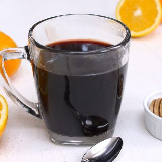 Elderberry Tea is a delicious and immune boosting tea that's made with dried elderberries, cinnamon, ginger, and honey. This healthy tea can strengthen the immune system and fight off a cold. Here is a simple and easy recipe that shows how you can make this natural remedy tea at home!