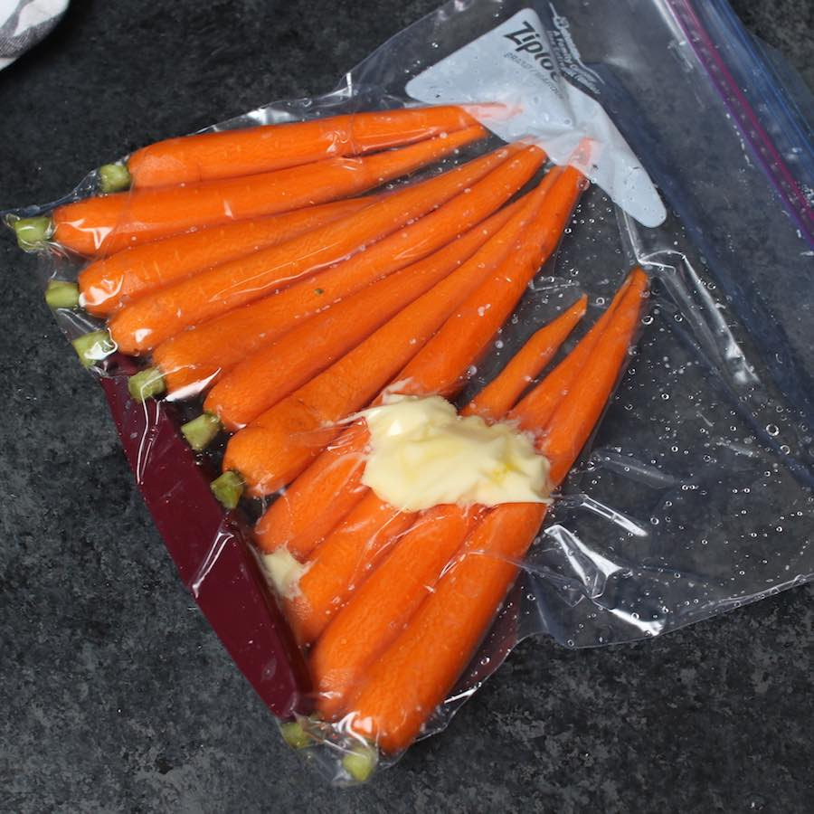 Vacuum-sealed carrots in a zip-loc bag.