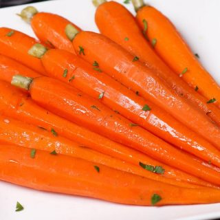 These Sous Vide Honey Glazed Carrots are tender and flavorful carrots simmered in a mixture of honey and butter, then topped with a sprinkling of parsley. The sous vide method transforms the carrots into the perfectly tender pieces. Sweet, savory and full of flavor, this recipe makes an amazing side dish for a holiday dinner or a week day meal.