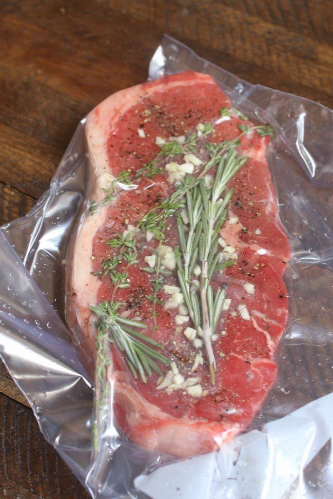 Vacuum-sealed steak in a zip-loc bag.