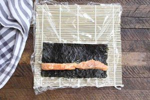 Place salmon strips on top of the nori.