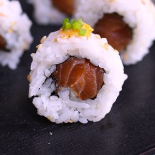 Spicy Salmon Rolls made with your favorite salmon tossed in sriracha spicy mayo, then rolled in nori seaweed sheet and fluffy sushi rice! You can easily customize the roll by adding other delicious ingredients. It's so much cheaper than the restaurant, and takes about 15 minutes from start to finish.  I'll share with you the secrets to make the best spicy salmon sushi, with step by step photos!