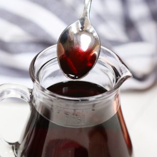Learn all you need to know for how to make Grenadine Syrup for cocktails and drinks! With only 2 ingredients – pomegranate juice and regular sugar, this recipe shows you some easy tips to make this delicious sweet and tart non-alcoholic bar syrup, with a beautiful bright red color. #Grenadine #GrenadineSyrup #GrenadineRecipe