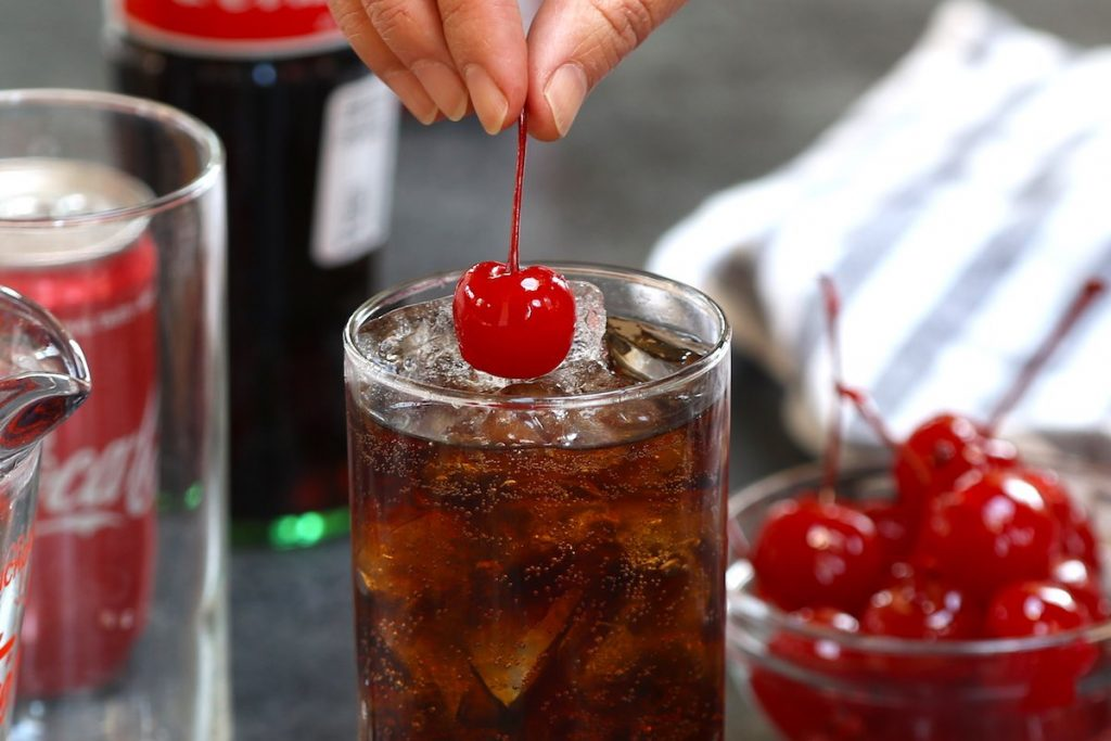 Garnishing with maraschino cherries.