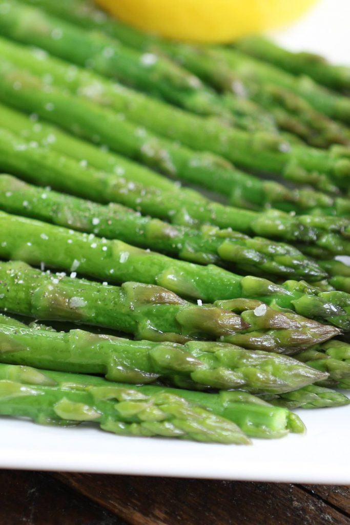 This easy and no-fail Sous Vide Asparagus is the perfect spring side dish recipe. Sous vide method brings out the best of asparagus with more concentrated flavor and the tender yet snappy texture. I'll share with you the basic seasoning as well as some variation ideas: lemon butter, garlic parmesan, or fresh herbs and garlic. #SousVideAsparagus