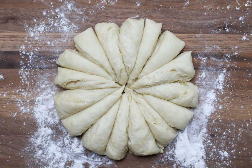 Dividing the dough into 16 equal portions.