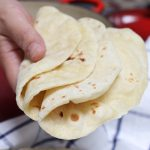 These Homemade Vegan Flour Tortillas are so soft and fluffy – a delicious and healthy alternative to traditional Mexican tortillas. This recipe is easy to make with only 5 inexpensive, easy-to-get ingredients, and can be done completely by hand!