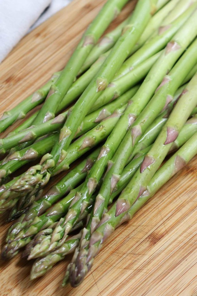 Fresh asparagus with bright green color. The tips are closed and compact.