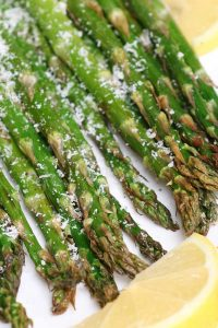 This Air Fryer Asparagus has crispy tips and tender stalks. It takes half of the time to cook with only 4 simple ingredients – the best roasted asparagus for a spring side dish! #AirFryerAsparagus #AirFryerVegetables