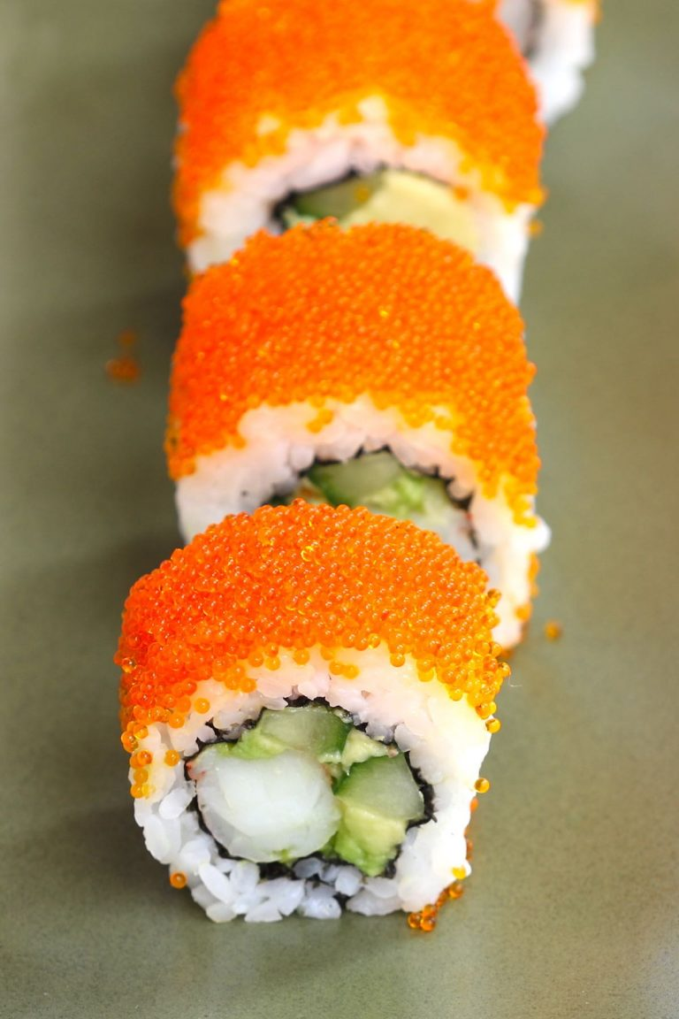 Boston Rolls are filled with creamy avocado, succulent shrimp, and crunchy cucumber, then rolled in nori seaweed sheet and sushi rice! It's usually garnished with the bright orange tobiko (Japanese flying fish roe). In this recipe, you will learn how to make sushi rice, how to select fillings, how to roll the the sushi, and how to garnish with tobiko! #BostonRoll #BostonSushi #BostonRollSushi