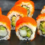 Boston Rolls are filled with creamy avocado, succulent shrimp, and crunchy cucumber, then rolled in nori seaweed sheet and sushi rice! It's usually garnished with the bright orange tobiko (Japanese flying fish roe). In this recipe, you will learn how to make sushi rice, how to select fillings, how to roll the the sushi, and how to garnish with tobiko!