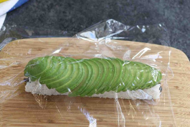 Place a piece of plastic wrap on top of the avocado.