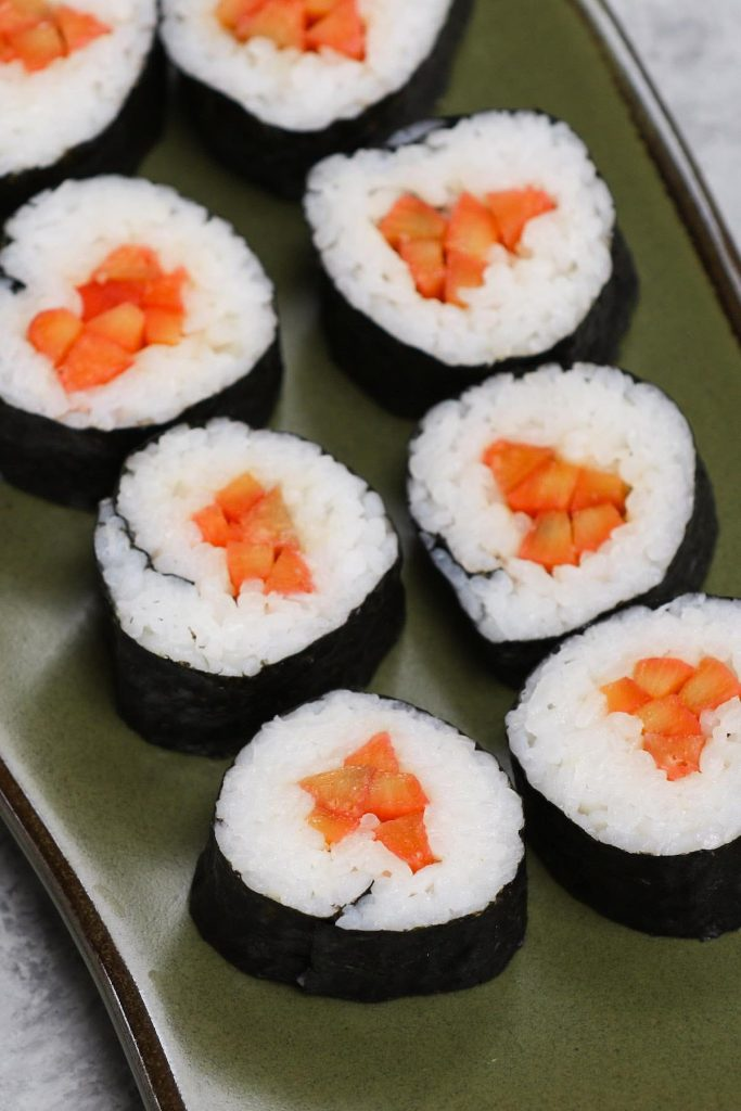 Gobo sushi rolls on a Japanese plate.