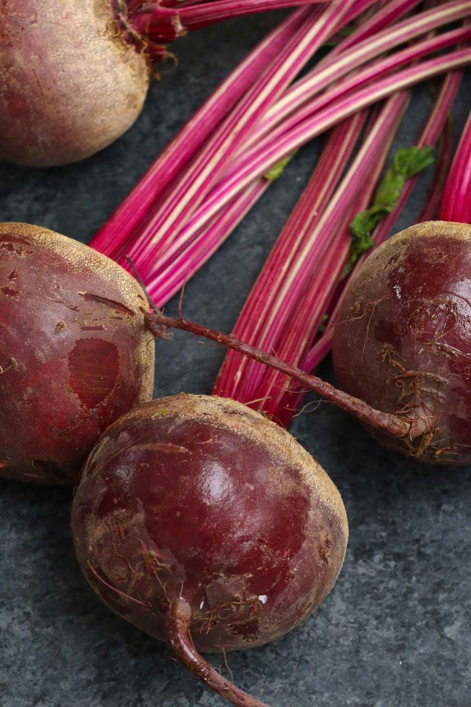 Fresh beets on the counter.