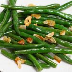Sous Vide Green Beans with incredible flavor and perfect crispy texture! Made with just a few simple ingredients including garlic, this no-fail sous vide recipe makes a delicious side dish to any main meal.