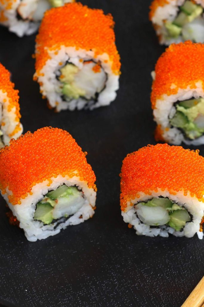 Sushi rolls topped with tobiko.